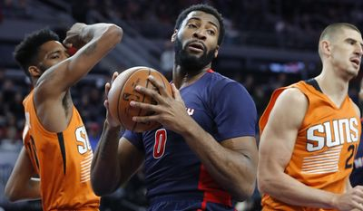 FILE - In this March 19, 2017, file photo, Detroit Pistons center Andre Drummond (0) rebounds against the Phoenix Suns in the first half of an NBA basketball game in Auburn Hills, Mich. Drummond admits he wasn't good enough this past season, but after a bit of trade speculation, he's still with the Pistons, hoping for a better performance in 2017-18.  (AP Photo/Paul Sancya)