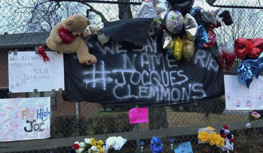 FILE - In this Feb. 14, 2017, file photo, a memorial is set up in a neighborhood where Nashville Officer Josh Lippert shot Jocques Scott Clemmons in Nashville, Tenn. Federal officials on Friday, Aug. 4, 2017, agreed with a state decision not to prosecute Lipper, a white Tennessee police officer, who fatally shot Clemmons,  a black man, after a traffic stop. (AP Photo/Jonathan Mattise, File)