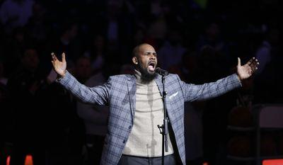 In this Nov. 17, 2015, file photo. musical artist R. Kelly performs the national anthem before an NBA basketball game between the Brooklyn Nets and the Atlanta Hawks in New York. (AP Photo/Frank Franklin II) ** FILE **