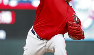 Minnesota Twins starting pitcher Bartolo Colon throws to the Texas Rangers in the second inning of a baseball game Friday, Aug. 4, 2017, in Minneapolis. (AP Photo/Bruce Kluckhohn)