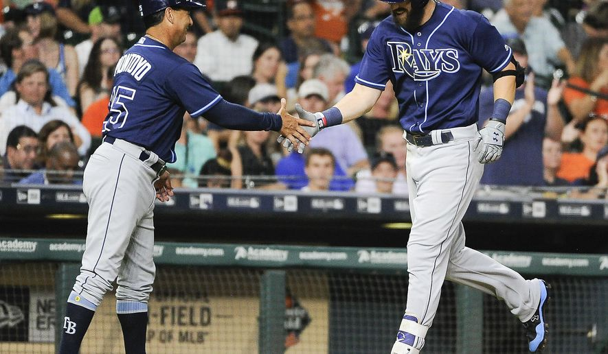 Tampa Bay Rays' Steven Souza Jr., right, shakes hands with third base coach Charlie Montoyo after hitting a solo home run off Houston Astros starting pitcher Collin McHugh during the sixth inning of a baseball game, Thursday, Aug. 3, 2017, in Houston. (AP Photo/Eric Christian Smith)