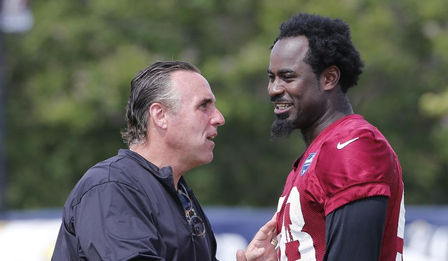 Washington Redskin defensive line coach, Jim Tomsula, talks with linebacker Junior Galette (58) during practice at NFL football training camp in Richmond, Va., Wednesday, Aug. 2, 2017. (AP Photo/Steve Helber) **FILE**