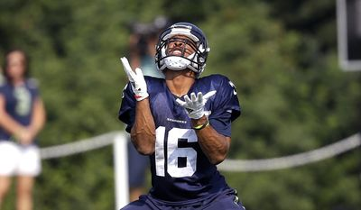Seattle Seahawks wide receiver Tyler Lockett reaches to catch a ball during NFL football training camp in Friday, Aug. 4, 2017, in Renton, Wash. (AP Photo/Elaine Thompson)