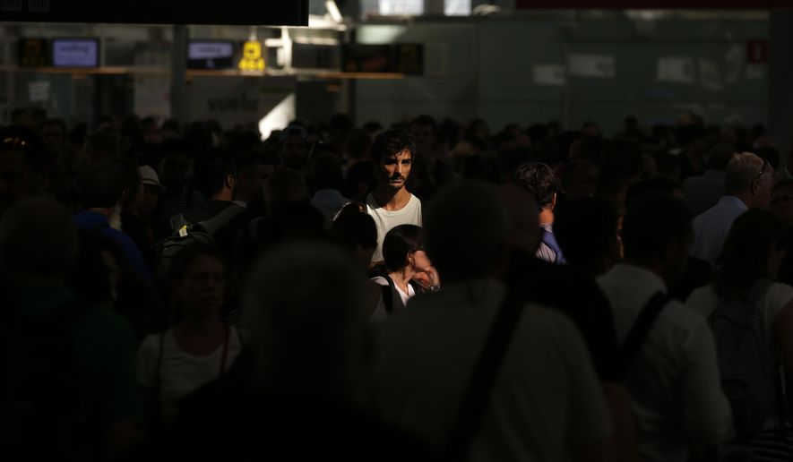 Passenger wait to pass the security control at the Barcelona airport in Prat Llobregat, Spain, Friday, Aug. 4, 2017.  Security workers at Barcelona airport began partial strikes Friday which threatens more queuing chaos for passengers at one of Europe's most popular airports. (AP Photo/Manu Fernandez)