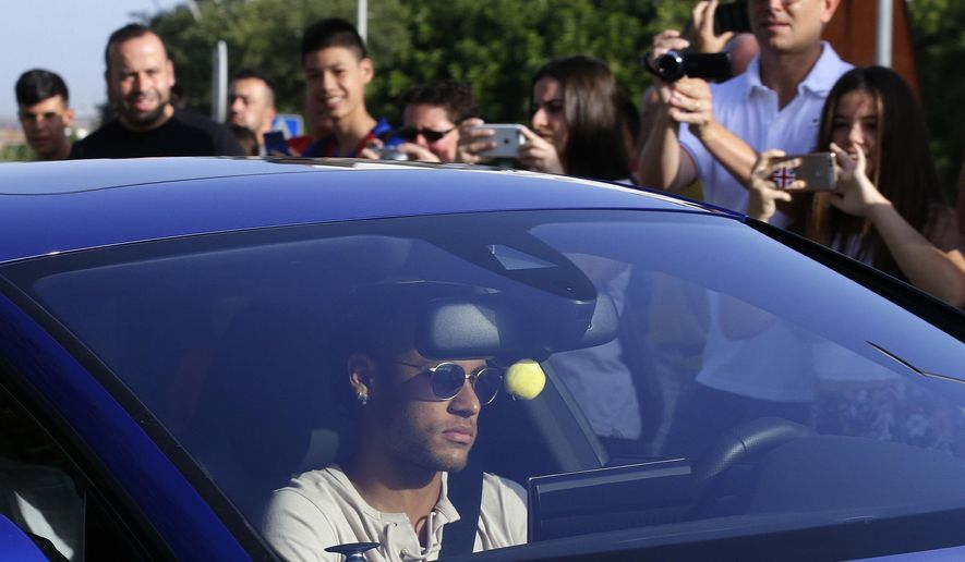 FC Barcelona's Neymar arrives at the Sports Center FC Barcelona Joan Gamper in Sant Joan Despi, Spain, Wednesday, Aug. 2, 2017. Neymar has arrived at Barcelona's training grounds amid widespread rumors that the Brazil striker could make a record-breaking move to Paris Saint-Germain. (AP Photo/Manu Fernandez)