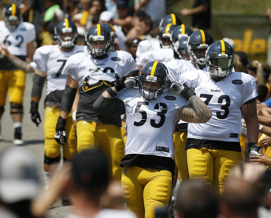 In this photo taken Sunday, July 30, 2017, Pittsburgh Steelers center Maurkice Pouncey (53) leads Ramon Foster (73), Alejandro Villanueva, (78) and the other offensive linemen past the fans to the practice fields at NFL football training camp in Latrobe, Pa. Even with their star-laden wide receiver group, the All-Pro running back and the franchise quarterback, the Steelers believe their high-powered offense will only go as far as their rock-solid offensive line can take them. (AP Photo/Keith Srakocic)