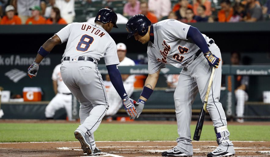 Detroit Tigers' Justin Upton, left, celebrates his solo home run with teammate Miguel Cabrera as he crosses home plate in the first inning of a baseball game against the Baltimore Orioles in Baltimore, Thursday, Aug. 3, 2017. (AP Photo/Patrick Semansky)