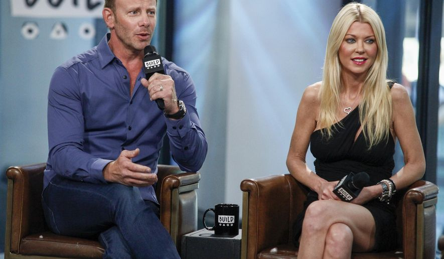 """FILE - In this Aug. 3, 2017 file photo, cast members Ian Ziering, left, and Tara Reid participate in the BUILD Speaker Series to discuss """"Sharknado 5: Global Swarming"""" at AOL Studios in New York. The film premieres Sunday on Syfy. (Photo by Andy Kropa/Invision/AP)"""