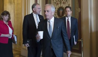 "Senate Foreign Relations Committee Chairman Sen. Bob Corker, R-Tenn., with panel member Sen. Tim Kaine, D-Va., second from left, arrives on Capitol Hill in Washington, Thursday, Aug. 3, 2107, where the committee approved the ""Taylor Force Act,"" which suspends U.S. financial aid to the Palestinian Authority until it stops rewarding Palestinians who kill American and Israeli citizens. (AP Photo/J. Scott Applewhite)"