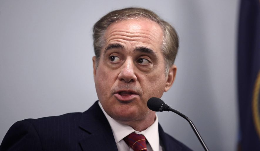 Secretary of Veterans Affairs David J. Shulkin addresses reporters during a visit to the Veterans Administration Medical Center in, Manchester, N.H., Friday, Aug. 4, 2017. Shulkin earlier met privately with doctors at the center, who have alleged substandard care at New Hampshire's only hospital for veterans. (AP Photo/Charles Krupa)
