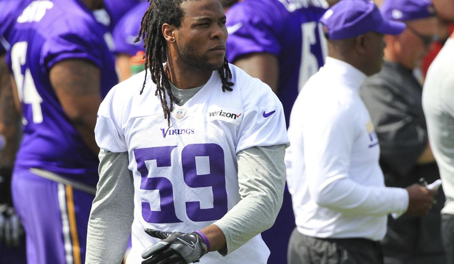 FILE - In this July 28, 2017, file photo, Minnesota Vikings defensive end Emmanuel Lamur (59) watches practice during NFL football training camp, in Mankato, Minn. With Chad Greenway retired, there's a rare opening in the lineup, with Emmanuel Lamur, Edmond Robinson and Ben Gedeon in the mix. (AP Photo/Andy Clayton-King, File)