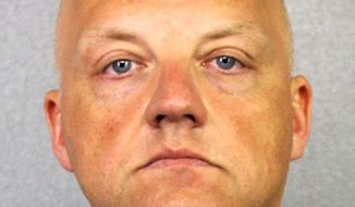FILE - This January 2017 file photo provided by the Broward County Sheriff's Office shows German Volkswagen executive Oliver Schmidt. Schmidt, a former manager of a VW engineering office in suburban Detroit, pleaded guilty Friday, Aug. 4, 2017, to conspiracy and fraud charges in Detroit in a scheme to cheat emission rules on nearly 600,000 diesel vehicles. (Broward County Sheriff's Office via AP, File)