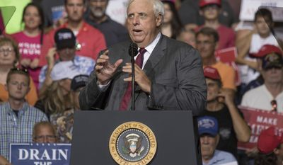 West Virginia Gov. Jim Justice announces his plan to change political parties from a Democrat to a Republican on Thursday, Aug. 3, 2017, at the Big Sandy Superstore Arena in Huntington, W.Va. (Evan Boggs /The Messenger-Inquirer via AP)