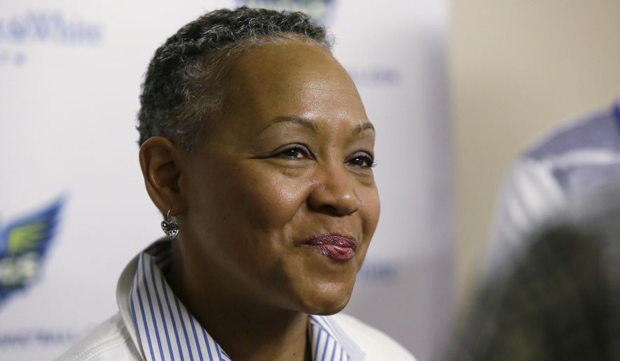 FILE - In this May 21, 2016. file photo, WNBA President Lisa Borders smiles as she speaks to reporters before a WNBA basketball game between the San Antonio Stars and the Dallas Wings in Arlington, Texas. Ever wanted to be the WNBA president for a day? Here's your chance. FanDuel is offering a free tournament next week where the winner of the contest will get to tour the WNBA offices with Borders. They will also get a photo with the WNBA trophy and have lunch with a legend of the league among other prizes for the winner. (AP Photo/LM Otero, File)