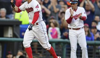 Cleveland Indians' Brandon Guyer scores on a throwing error by New York Yankees' Aaron Judge in the third inning of a baseball game, Friday, Aug. 4, 2017, in Cleveland. (AP Photo/David Dermer)