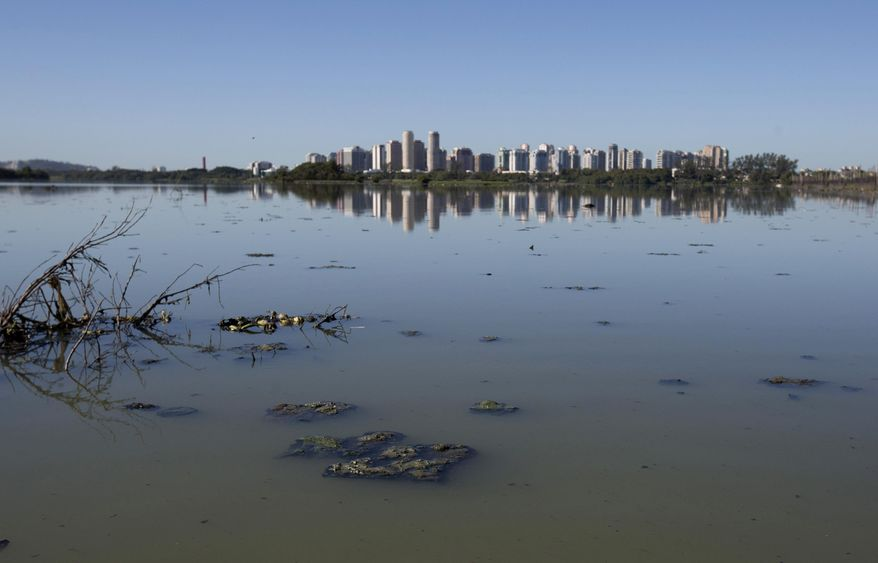 This July 31, 2017 photo, shows the heavily polluted Jacarepagua lagoon, in Rio de Janeiro, Brazil. In it's Olympic bid, Rio promised to clean up the bay and up its treatment of sewage, promises that were not kept. (AP Photo/Silvia Izquierdo)