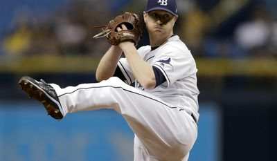 Tampa Bay Rays' Alex Cobb goes into his wind up against the Milwaukee Brewers during the first inning of a baseball game Saturday, Aug. 5, 2017, in St. Petersburg, Fla. (AP Photo/Chris O'Meara)