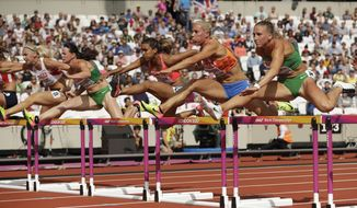 Austria's Ivona Dadic, Hungary's Gyorgyi Zsivoczky-Farkas, Puerto Rico's Alysbeth Felix, Netherlands' Nadine Broersen and Hungary's Xenia Krizsan, from left, clear a hurdle in the 100-meter hurdles of the heptathlon during the World Athletics Championships in London Saturday, Aug. 5, 2017. (AP Photo/Matt Dunham)