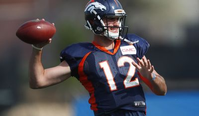 Denver Broncos quarterback Paxton Lynch throws a pass during an NFL football training camp. Saturday, Aug. 5, 2017, in Englewood, Colo. (AP Photo/David Zalubowski)