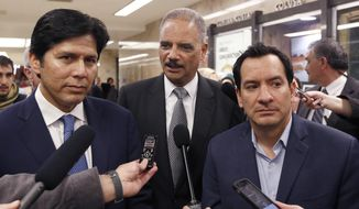 "FILE - In this Feb. 7, 2017 file photo, former U.S. Attorney General Eric Holder, center, flanked by California Senate President Pro Tem Kevin de Leon, D-Los Angeles, left, and Assembly Speaker Anthony Rendon, D-Paramount, talks to reporters before meeting with Calif., Gov. Brown, in Sacramento, Calif. A recall effort against Rendon, a strong progressive now targeted by party activists upset that he derailed a bill seeking government-funded health care for all. Rendon said he supports single-payer health care in concept, but SB562 was ""woefully incomplete."" (AP Photo/Rich Pedroncelli, File)"