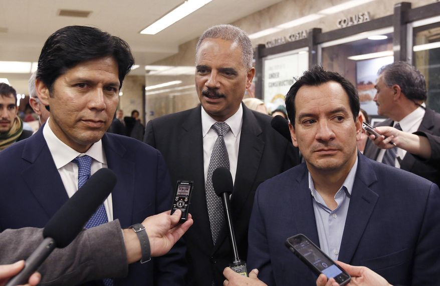 """FILE - In this Feb. 7, 2017 file photo, former U.S. Attorney General Eric Holder, center, flanked by California Senate President Pro Tem Kevin de Leon, D-Los Angeles, left, and Assembly Speaker Anthony Rendon, D-Paramount, talks to reporters before meeting with Calif., Gov. Brown, in Sacramento, Calif. A recall effort against Rendon, a strong progressive now targeted by party activists upset that he derailed a bill seeking government-funded health care for all. Rendon said he supports single-payer health care in concept, but SB562 was """"woefully incomplete."""" (AP Photo/Rich Pedroncelli, File)"""