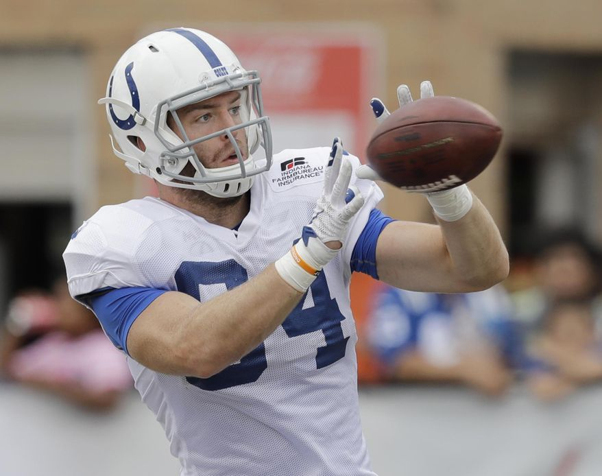 Indianapolis Colts tight end Jack Doyle (84) makes a catch during practice at the NFL football team's training camp Saturday, Aug. 5, 2017, in Indianapolis, (AP Photo/Darron Cummings)