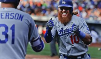 Los Angeles Dodgers' Justin Turner (10) celebrates after hitting a solo home run against the New York Mets during the eighth inning of a baseball game, Saturday, Aug. 5, 2017, in New York. (AP Photo/Julie Jacobson)