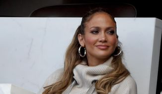 Jennifer Lopez watches a baseball game between the New York Mets and the Los Angeles Dodgers, Saturday, Aug. 5, 2017, in New York. (AP Photo/Julie Jacobson) ** FILE **