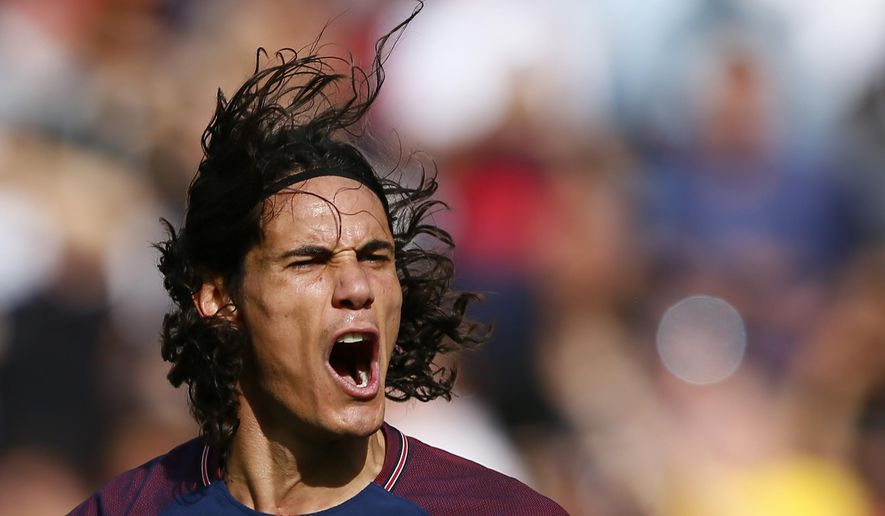 PSG's Edinson Cavani celebrates after scoring a goal during the French major soccer league opening match between Paris Saint-Germain and Amiens at the Parc des Princes stadium in Paris Saturday, Aug. 5, 2017. (AP Photo/Francois Mori)