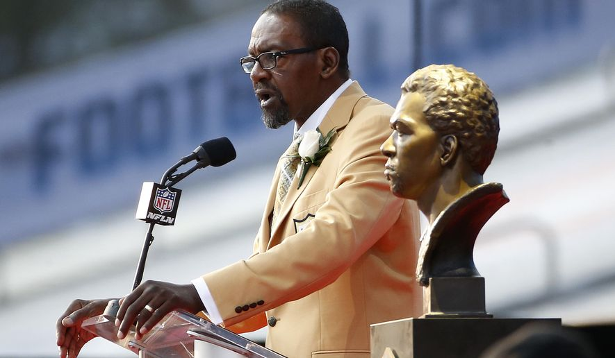 Former NFL player Kenny Easley speaks next a bust of himself during an induction ceremony at the Pro Football Hall of Fame Saturday, Aug. 5, 2017, in Canton, Ohio. (AP Photo/Ron Schwane)