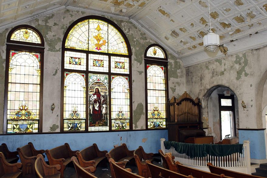 This Aug. 1, 2017, photo shows the main room of the Mount Zion Baptist Church on Carpenter Street in Athens, Ohio.  A group is working to preserve and restore the historically significant church that once served as a hub for blacks living in southeast Ohio. Mount Zion Baptist Church has remained empty and largely abandoned for more than a decade. Mount Zion Baptist Church Preservation Society recently gained control of the building after a years-long battle.  [Brooke LaValley/Columbus Dispatch]/The Columbus Dispatch via AP)