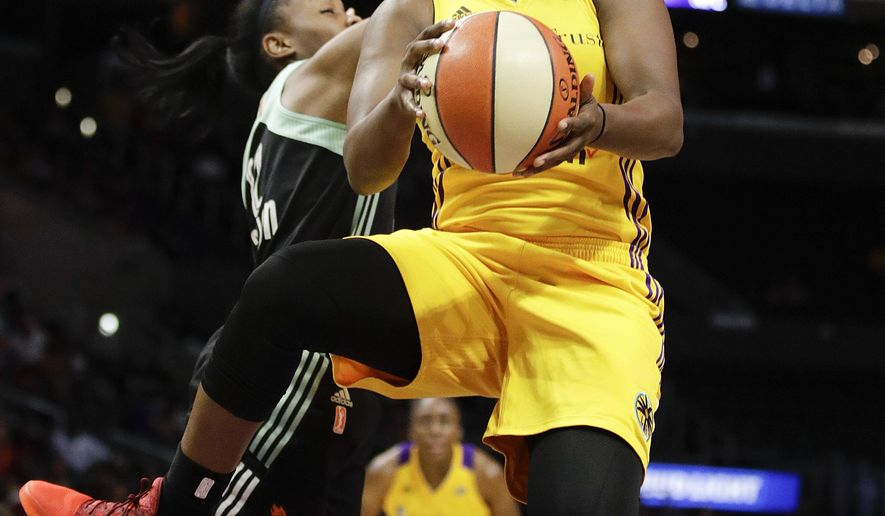 Los Angeles Sparks' Chelsea Gray, center, drives toward the basket past New York Liberty's Lindsay Allen during the first half of a WNBA basketball game, Friday, Aug. 4, 2017, in Los Angeles. (AP Photo/Jae C. Hong)
