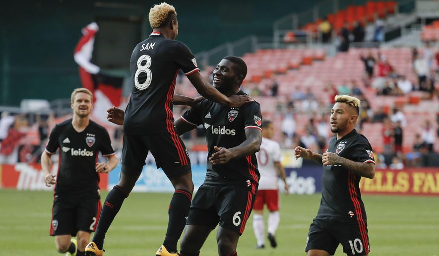 D.C. United defender Kofi Opare (6) celebrates his goal with teammates from l-r, Taylor Kemp (2), Lloyd Sam (8), and Luciano Acosta (10) against Toronto FC during the first half of an MLS soccer match, Saturday, Aug. 5, 2017, in Washington. (AP Photo/Pablo Martinez Monsivais)
