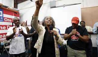 Nissan employee Betty Jones expresses her disappointment at pro-union supporters losing their bid to form a union at the Nissan vehicle assembly plant in Canton, Miss., Friday, Aug. 4, 2017.  (AP Photo/Rogelio V. Solis)