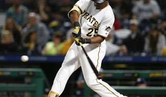 Pittsburgh Pirates' Gregory Polanco hits a three-run home run off San Diego Padres relief pitcher Kirby Yates during the seventh inning of a baseball game, Friday, Aug. 4, 2017, in Pittsburgh. (AP Photo/Keith Srakocic)