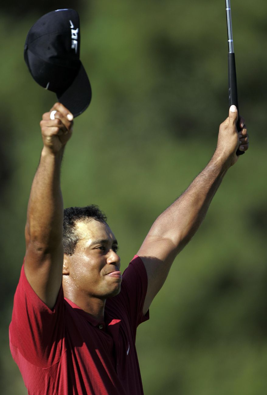 FILE- In this Aug. 12, 2007, file phoot, Tiger Woods celebrates after winning the 89th PGA Golf Championship at the Southern Hills Country Club in Tulsa, Okla. (AP Photo/Rob Carr, File)