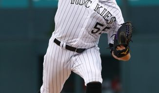 Colorado Rockies starting pitcher Jon Gray delivers to Philadelphia Phillies' Daniel Nava in the first inning of a baseball game Saturday, Aug. 5, 2017, in Denver. (AP Photo/David Zalubowski)