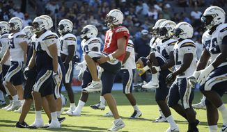 Los Angeles Chargers players warm up before a joint practice with the Los Angeles Rams during an NFL football training camp at StubHub Center, Saturday, Aug. 5, 2017, in Carson, Calif. (AP Photo/Jae C. Hong)