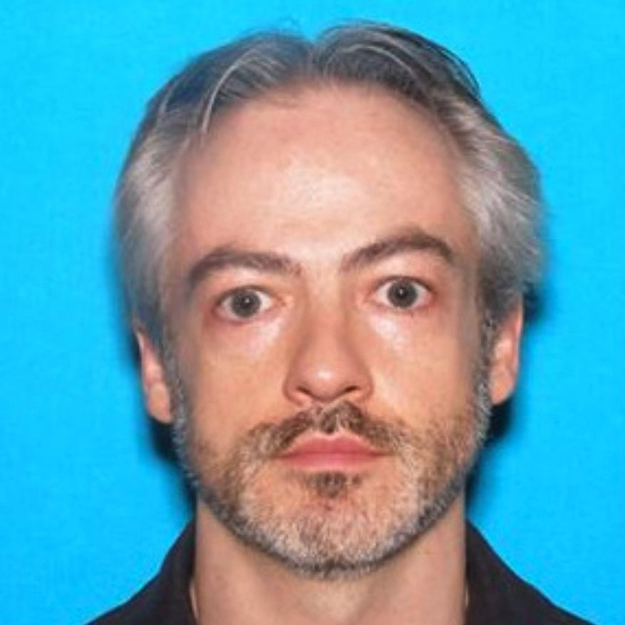 FILE - This undated file photo released by the Chicago Police Department shows Wyndham Lathem, an associate professor of microbiology and immunology at Northwestern University. Lathem and Andrew Warren, an employee of the University of Oxford in Britain, both wanted in the fatal stabbing of a Chicago man have been taken into custody in Oakland, California, a Chicago police spokesman said Friday, Aug. 4, 2017  (Chicago Police Department via AP)