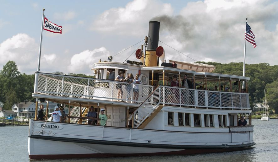 The steamboat Sabino cruises the Mystic River in Mystic, Conn., Thursday, Aug. 3, 2017. The vessel, billed by the Mystic Seaport maritime museum as the nation's oldest coal-fired steamboat in regular operation, resumed public cruises on Wednesday after a two-year, $1.1 million restoration project. (Andy Price/Mystic Seaport via AP)