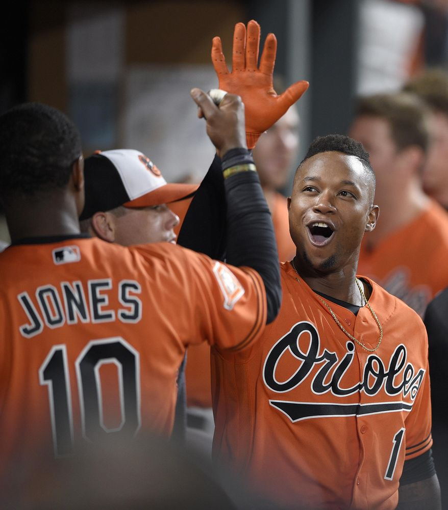 Baltimore Orioles' Tim Beckham (1) celebrates his home run in the dugout with Adam Jones (10) during the eighth inning of a baseball game against the Detroit Tigers, Saturday, Aug. 5, 2017, in Baltimore.(AP Photo/Nick Wass)