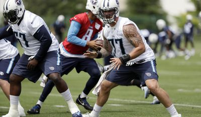 FILE - In this May 23, 2017, file photo, Tennessee Titans tackle Taylor Lewan (77) runs a drill during the team's organized team activity at its NFL football training facility, in Nashville, Tenn. The Titans finally stabilized their offensive line in 2016 with left tackle Taylor Lewan voted to the Pro Bowl, while rookie Jack Conklin was an All Pro at right tackle.(AP Photo/Mark Humphrey, File)
