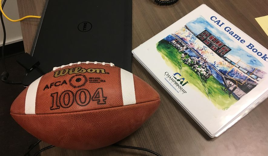 A CAI Game Book lies on a desk at Fordham University in New York, Thursday, Aug. 3, 2017. When it comes to NCAA college football in-game strategy, a six-year-old company named Championship Analytics, Inc., is quickly making a mark. CAI has gone from three schools subscribing to its service in 2014 to 53 this year, including 38 FBS teams. Using a patented system of statistical analysis, CAI provides its clients each week with a game book, a three-ring binder stuffed with pages of color-coded charts and a by-the-numbers breakdown of the matchup. Taking strengths and weaknesses of each team into account, the game book lays out possible scenarios and gives strategic recommendations based on which option provides the best odds of winning. (AP Photo/Ralph Russo)
