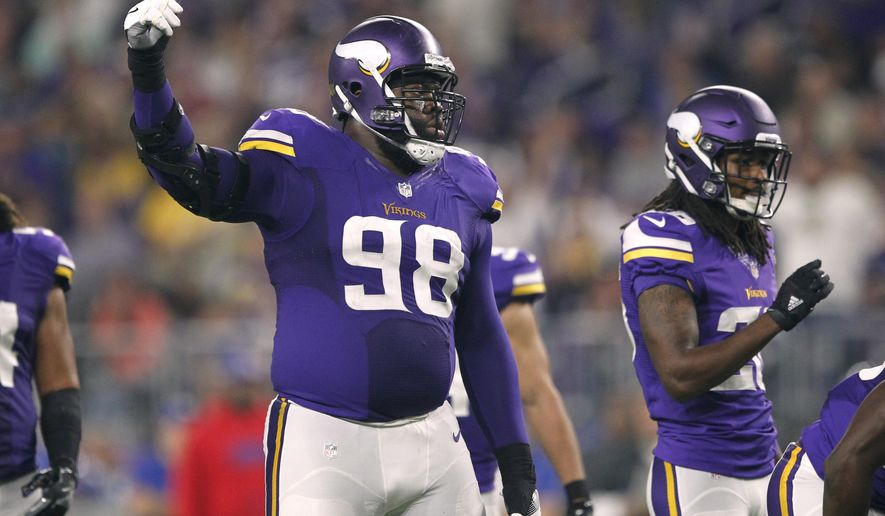 FILE - In this Oct. 3, 2016, file photo, Minnesota Vikings nosse tackle Linval Joseph (98) reacts during the first half of the team's NFL football game against the New York Giants in Minneapolis. The Vikings have locked up another core piece of their defense, agreeing to a contract extension with Joseph. Joseph's agency, SportsTrust Advisors, announced the deal Saturday, Aug. 5, 2017. NFL Media reported it's a four-year extension worth as much as $50 million with $31.5 million in guaranteed money. (AP Photo/Andy Clayton-King, File)