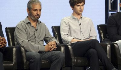 """David Shore, left, and Freddie Highmore participate in the """"The Good Doctor"""" panel during the Disney ABC Television Critics Association Summer Press Tour at the Beverly Hilton on Sunday, Aug. 6, 2017, in Beverly Hills, Calif. (Photo by Willy Sanjuan/Invision/AP)"""