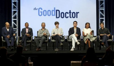 """Richard Schiff, from left, Hill Harper, David Shore, Freddie Highmore, Daniel Dae Kim, Antonia Thomas and Nicholas Gonzalez participate in the """"The Good Doctor"""" panel during the Disney ABC Television Critics Association Summer Press Tour at the Beverly Hilton on Sunday, Aug. 6, 2017, in Beverly Hills, Calif. (Photo by Willy Sanjuan/Invision/AP)"""