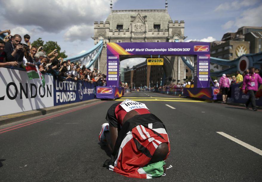 Kenya's Geoffrey Kipkorir Kirui celebrates after winning the gold medal in the Men's Marathon during the World Athletics Championships Sunday, Aug. 6, 2017.(AP Photo/Tim Ireland)