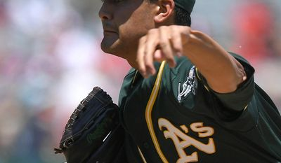 Oakland Athletics starting pitcher Sean Manaea throws to the plate during the first inning of a baseball game against the Los Angeles Angels, Sunday, Aug. 6, 2017, in Anaheim, Calif. (AP Photo/Mark J. Terrill)