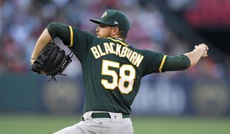 Oakland Athletics starting pitcher Paul Blackburn throws to the plate during the first inning of a baseball game against the Los Angeles Angels, Saturday, Aug. 5, 2017, in Anaheim, Calif. (AP Photo/Mark J. Terrill)