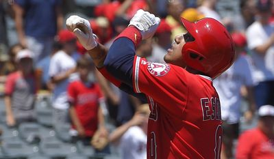 Los Angeles Angels' Yunel Escobar gestures after hitting a solo home run during the first inning of a baseball game against the Oakland Athletics, Sunday, Aug. 6, 2017, in Anaheim, Calif. (AP Photo/Mark J. Terrill)